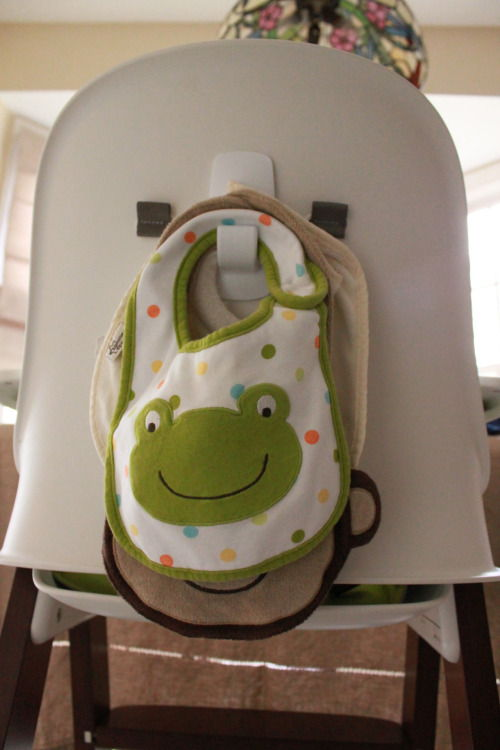 Putting a hook on the back of your highchair for bibs