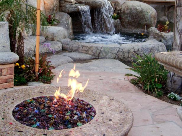 ... feature, fire pit, tiki lights, plants, and shade. (via DIY Network