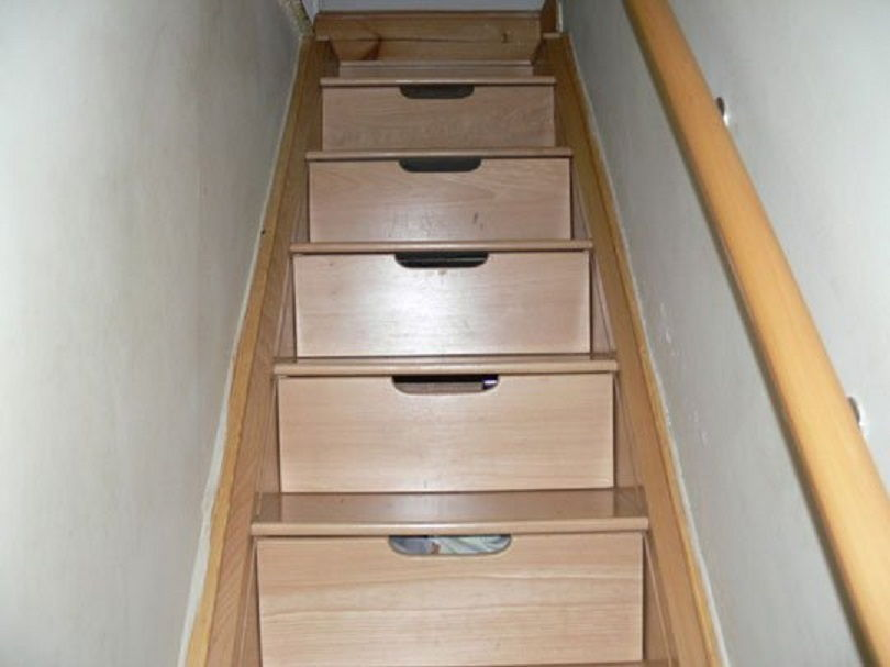 35 awesome secret hiding places to stash your stuff page for Secret stair storage