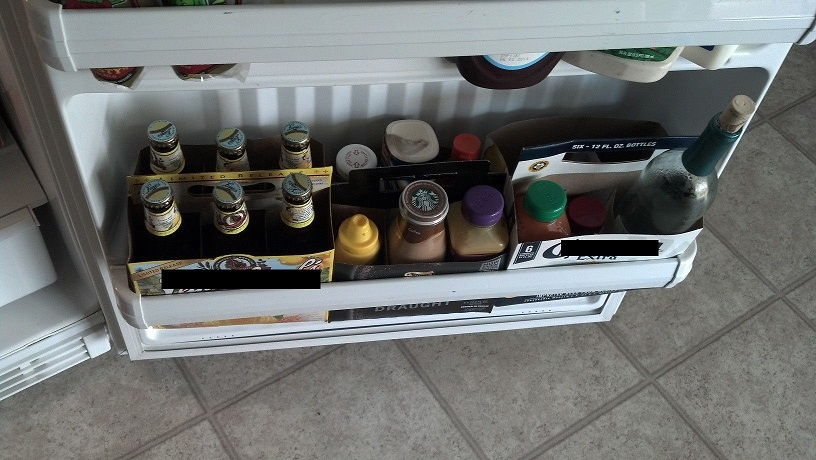 Use empty beer six pack containers to help organize your fridge door
