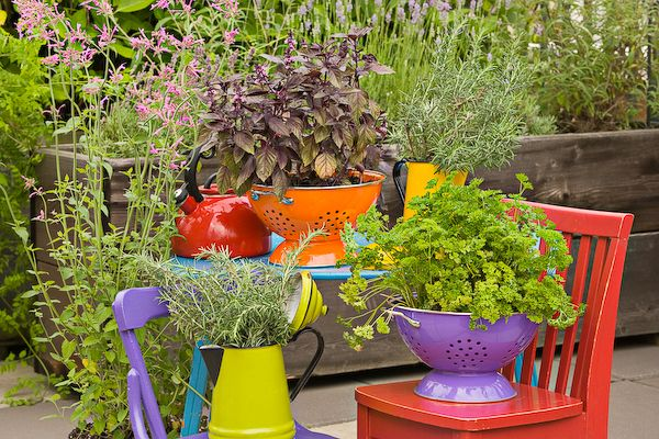 Colorful colanders turned into planters