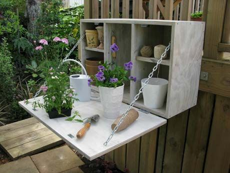 Outdoor storage cabinet that doubles as a potting bench