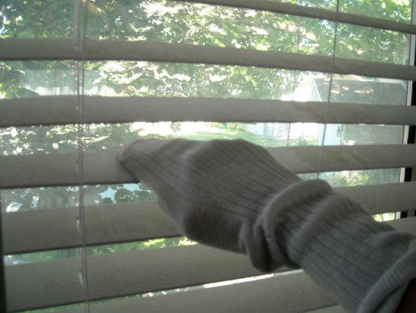 Vinegar, water and an old sock are all the items you need to clean blinds
