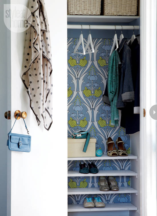 Closet Backed with a Bold Printed Wallpaper