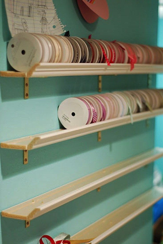 Organize Large Rolls of Ribbon on Crown Molding Shelves