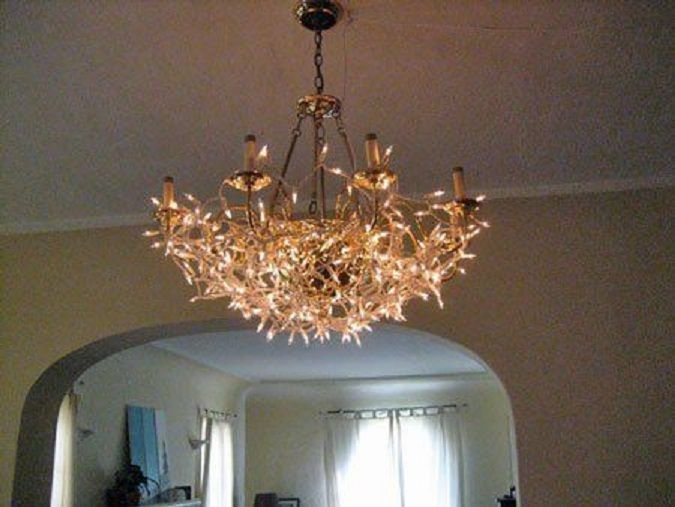 35 super cozy ways to use string lights at home page 4 16 chandelier cover up mozeypictures Choice Image